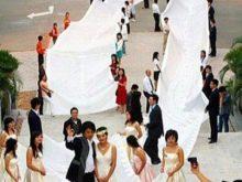 Одно из самых длинных свадебных платьев