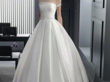 Свадебное платье пышное с коротким рукавом