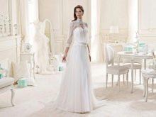 Свадебное платье от Nicole Fashion Group закрытое