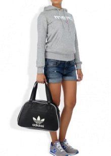 f912b2a868d1 Под именем этой марки выпускается высококачественная обувь, одежда и  аксессуары. Фирменные сумки от Adidas прославились благодаря яркому и  продуманному ...