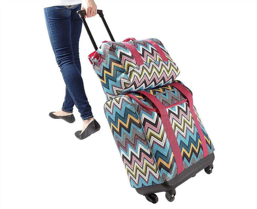 2deaf0824833 Дорожные сумки на колесах (68 фото): модели с выдвижной ручкой, как ...
