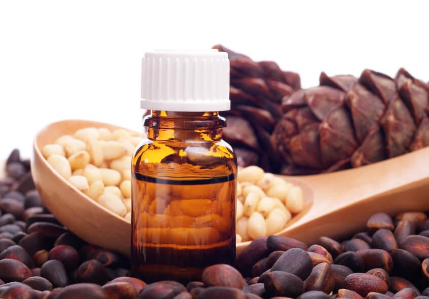 Эфирное масло кедра - свойства и применение для волос и лица