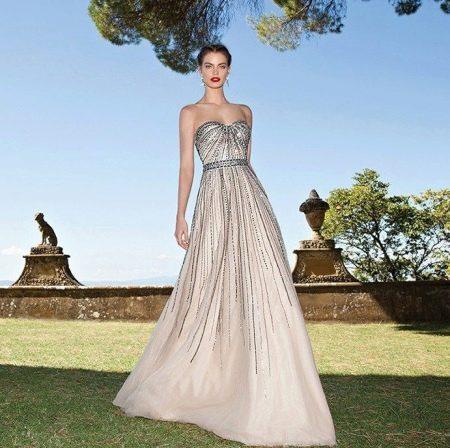 Вечернее платье от Тарик Эдиз бежевое