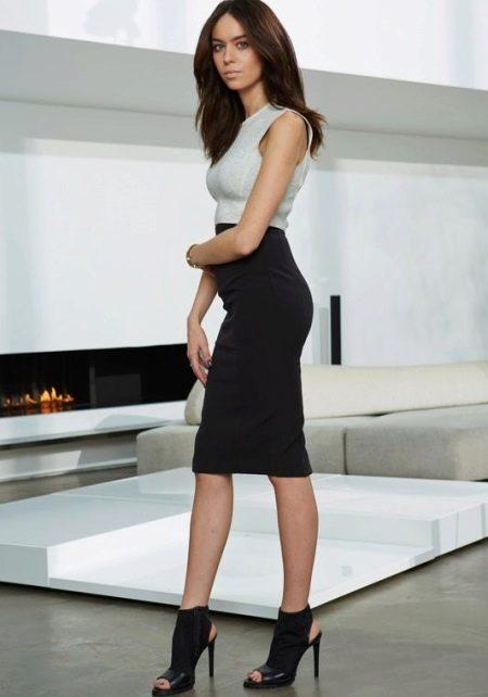 Черная юбка карандаш длины миди для девушек с красивыми формами ног