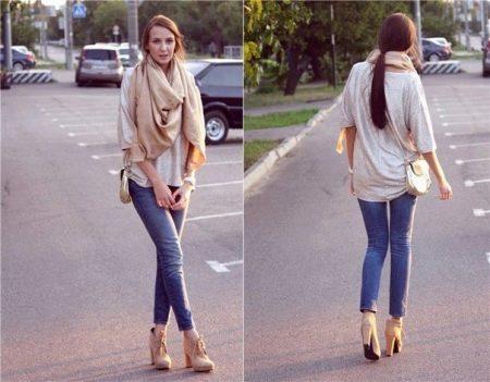 Если вы предпочитаете спортивный и комфортный стиль для повседневного  образа, то можете смело к кедам и джинсам добавить леопардовый шарф. 991a52b1758